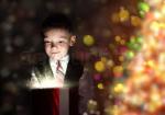boy opening christmas gift